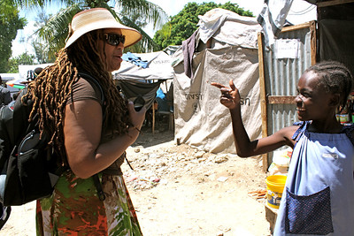 A young friend in Grace International's refugee camp greets team member Nikita Patterson.