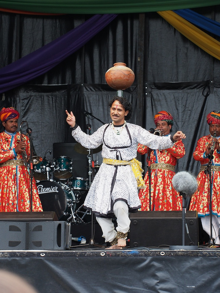 The dancing 'fakir', Jaipur Maharajah Brass Band, Commonwealth Stage, Jubilee Family Day.<br /> <br /> He eventually graduated to having the pot balanced on 4 glasses, while walking over knives and a bed of nails.
