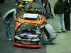 Drivers enter their cars to begin the nights racing