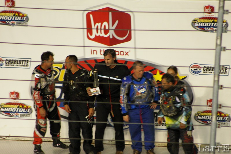 the lawnmower pilots gather after their race
