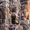 Giant faces of the Bayon temple at Angkor