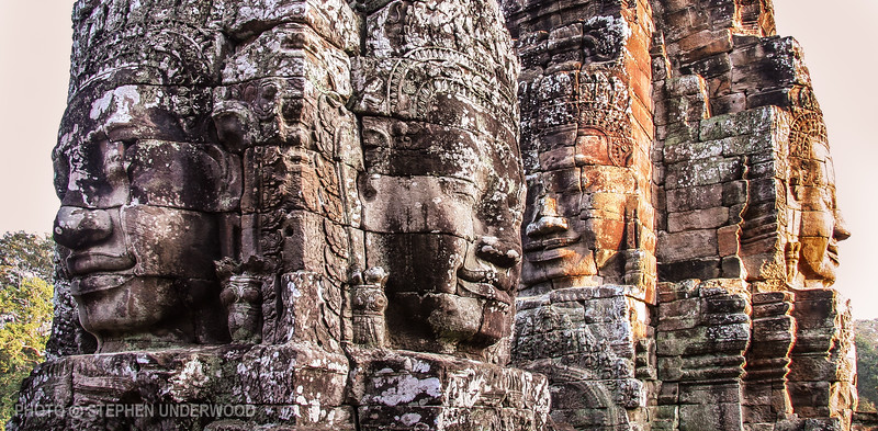 Giant faces of the Bayon temple at Angkor