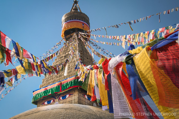 Boudhanath Stupa near Kathmandu is one of the largest in the world and is a confusion of color and spiritual activity