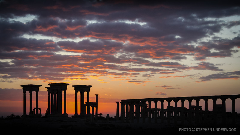Sunrise behind columns at Palmyra