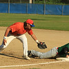 Legions Eddie Cuddahy attempt the 1st base tag to Sturbridges Tyler Stoever