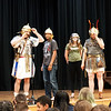 Andy Volpe of Legion III Cyrenaica explains to students of the Richardson Middle school the construction of a Roman helmet, while (left to right) students Andy Neng, Hanna Patterson and reenactor Quinton Johansen observe. (Sun / Chris Tierney)