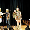 Andy Volpe of Legion III Cyrenaica demonstrates use of Roman sword and helmet with student Andy Neng at the Richardson Middle School in Dracut, while (left to right) students Hanna Patterson and reenactor  Quinton Johansen observe. (Sun / Chris Tierney)