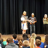 Andy Volpe of Legion III Cyrenaica addresses students at the Richardson Middle School in Dracut about Roman soldier life, while (left to right) students Andy Neng, Hanna Patterson and reenactor  Quinton Johansen observe. (Sun / Chris Tierney)