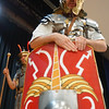 Andy Volpe explains to students at the Richardson Middle School what a Roman shield is made out of while Quinton Johansen of Legion III Cyrenaica looks on. (Sun / Chris Tierney)