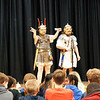 Roman reenactor Quinton Johansen of Legion III Cyrenaica shows Roman artifacts to students at The Richardson Middle School, while Andy Volpe looks on. (Sun / Chris Tierney)