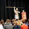 Andy Volpe of Legion III Cyrenaica demonstrates use of spear, while  Quinton Johansen (left) and student Jayen Hood with shield look on. (Sun / Chris Tierney)