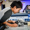 Michael Xing, 12, of Belmont sets up their teams robot to compete in the Lego building event at the Nashoba Valley Technical High School in Littleton. SUN/Caley McGuane