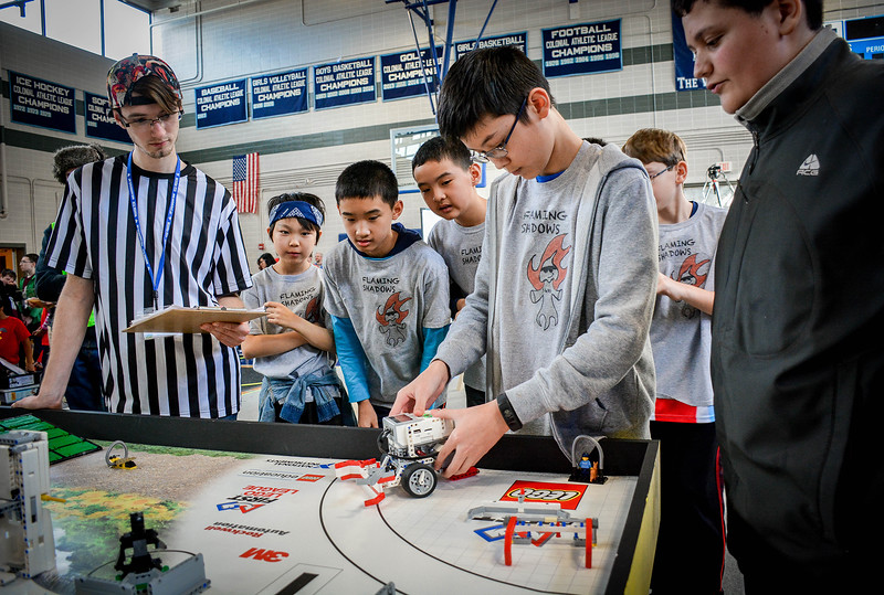 Kyle Owen, 13, of Westford sets up his robot for their team, the Flaming Shadows during the Lego building competition at Nashoba Tech in Littleton. SUN/Caley McGuane