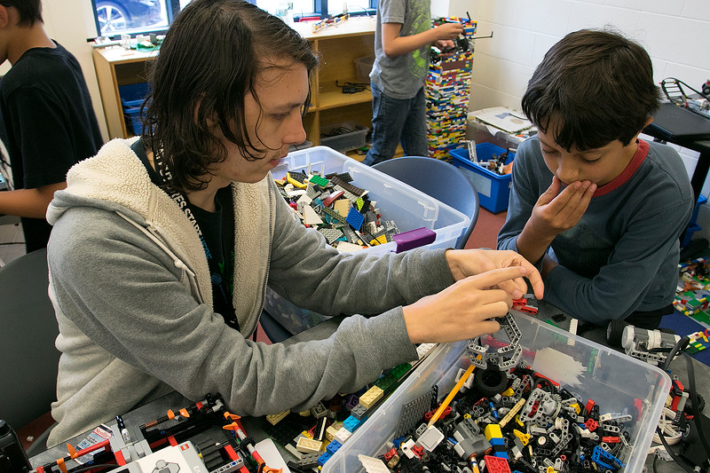 On Tuesday afternoon at the Boys and Girls Club of Fitchburg and Leominster some of the kids took part in the Lego robotics activity. Instructor Ryan Weston helps Nicholas Letarte, 9, from Leominster work out a problem with his battle bot during the activity. SENTINEL & ENTERPRISE/JOHN LOVE