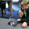 On Tuesday afternoon at the Boys and Girls Club of Fitchburg and Leominster some of the kids took part in the Lego robotics activity. Cole Allaire, 10, from Winchendon works on getting his Lego launcher to work like he wants it to during the activity. SENTINEL & ENTERPRISE/JOHN LOVE