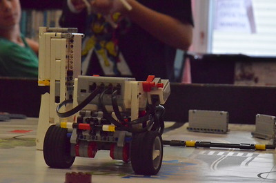 Leah McDonald - Oneida Daily Dispatch Lego Robotics participants take practice runs of a course at the Oneida Public Library on Friday, Aug. 11, 2017.