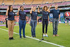 As part of Armed Forces Week, current member of the Leidos Board of Directors and prior Leidos CEO (and retired USAF Chief of Staff) John Jumper with USAF enlistees reciting the enlistment oath before the soccer match between the DC United and the Orlando City SC.
