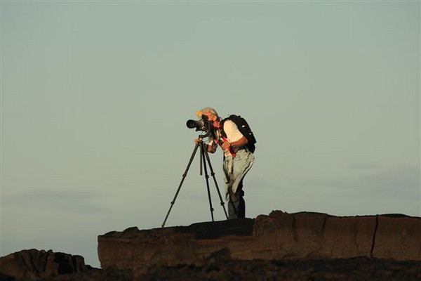 Videographer Leigh Hilbert making  molten lava movie-- taking coastal scenes