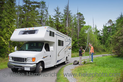 Family filling Freshwater in Motor Home at Dumping Station - Pacific Rim National Park, Vancouver Island, British Columbia, Canada