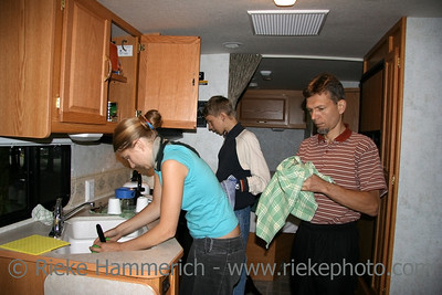 family in a new motorhome  - doing the dishes - adobe RGB