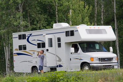 Big Motorhome with owner in the woods - Wells Gray Provincial Park, British Columbia, Canada