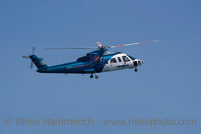 Blue Helicopter in Flight - Near Victoria, Vancouver Island, British Columbia, Canada