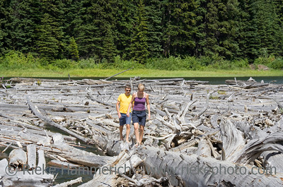 Father and Daughter balancing on Dead Trees - Duffey Lake, Coast Mountains, British Columbia, Canada