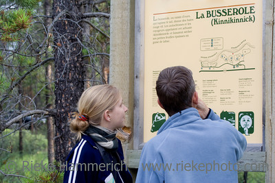 father and daughter looking at a signpost - jasper national park, alberta - adobe RGB