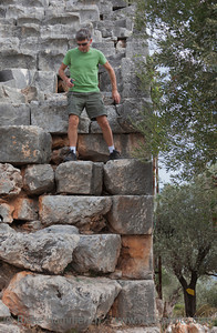 Mature Man moving down in ancient Amphitheater - Kas, Antalya Province, Turkey, Asia