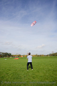 man flying a power kite - action in an old industrial area with a shaft tower - adobe RGB