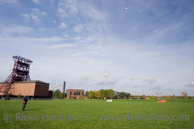 man with a power kite - action in an old industrial area with a shaft tower - adobe RGB