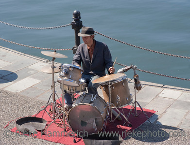 Victoria, British Columbia, Canada – August 2, 2005: Street Musician playing the drums on the quay of the Inner Harbour of Victoria, Canada. The Inner Harbour is a lively area filled with artisans.