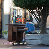 Victoria, British Columbia, Canada – August 2, 2005:<br /> Street Musician playing piano in front of a clothing store in the pedestrian zone of Victoria, Canada.
