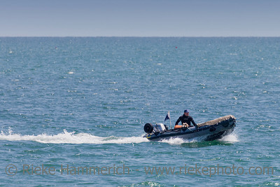 At Sea - July 1, 2011: Angler enjoying ride with speedboat on the English Channel near Saint-Vaast-la-Hougue, France. Strong currents and hidden cliffs make this part of the atlantic ocean dangerous for shipping.