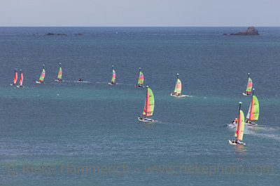 SAINT-MALO, FRANCE - JULY 6: Group of teenagers learning catamaran sailing on the coast of Saint-Malo, France on July 6, 2011. Their Hobie Cat Teddy catamarans are 13 feet long and have a great buoyancy.