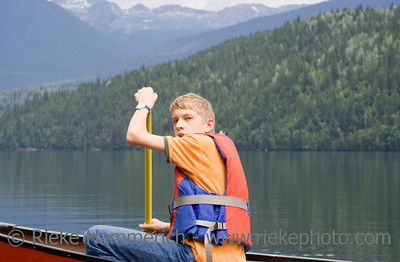 Teenage boy canoeing - Clearwater Lake, Wells Gray Provincial Park, British Columbia, Canada