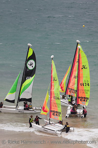 SAINT-MALO, FRANCE - JULY 6: Group of teenagers learning catamaran sailing on the coast of Saint-Malo, France on July 6, 2011. Their Hobie Cat 15 catamarans are 15 feet long and have a great buoyancy.