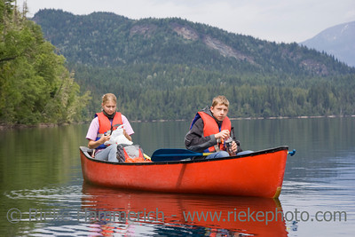 Girl and boy canoeing - Clearwater Lake, Wells Gray Provincial Park, British Columbia, Canada