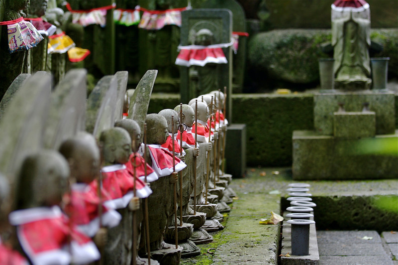 56 • Jizo  • The red bibs are offerings by mothers to Jizo, to encourage him to take special care of their children's spirits. • Nara, Japan • 2007 (posted 3/4/11)