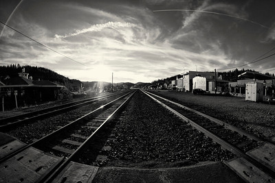 91 • Gratuitous Train Tracks  • As the sun sets to the west of the Sierra Nevada Mountains on the last day of 2011 • First week to play with my new 8mm Rokinon fish eye lens • Processing with NIK Silver EFX Pro • Truckee, CA • 2011 (New Year's Eve) (posted 1/1/2012)