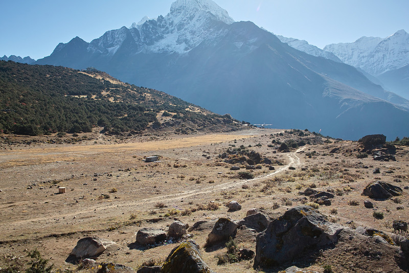 On an acclimatization hike up to Khumjung:  Two-seater plane landing at Shyanboche airstrip.