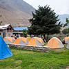 Camping (blue tent is mine) with large group at Dunai.