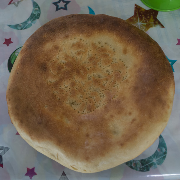 'Tandir naan' but nothing like the tandoori breads in India.  I call it 'hubcab bread'.  Staple food.