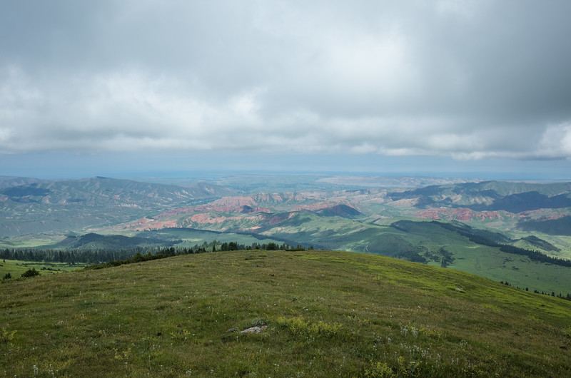 The weather was crap, so this retreat downhill actually gave us the only views possible, overlooking the colorful flatlands and Issyk-Kul.(The thin strip of blue between clouds and land.)