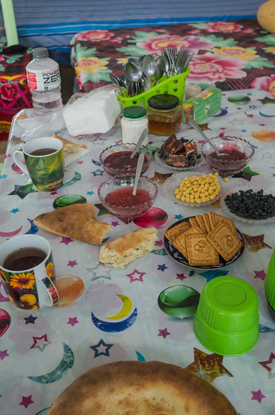 Some other stuff typically seen on the Kyrgyz table:  Biscuits ('cookies' to us), jams, chai, wrapped candies.  Note: spoons and forks, but no knives.  Also typical.