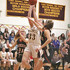 MIKE WALSH — THE BERKSHIRE EAGLE<br /> Lenox's Mia Giardina bullies her way into the paint for a bucket late in the fourth quarter of a home win over South Division rival Lee.