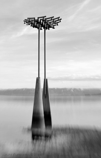 """Klokkespelet i Hamar.  Carillon at Hamar, Norway. In play (pun intended) from 2004. Placed out in Lake Mjøsa. (Photo taken in april, at low water level after winter.)<br /> <br /> See <a href=""""http://www.hamar.kommune.no/category6173.html"""">http://www.hamar.kommune.no/category6173.html</a> (norwegian only)<br /> <br /> Edited in PSE12 and Silver Efex Pro 2."""