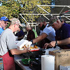 St. Vincent de Paul Men's Club members work filling orders at the drive-thru section of their fish fry which takes place every Friday in Lent. (NTC photo/Donna Ryckaert)