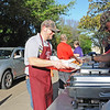 St. Vincent de Paul Parish Men's Club member, Aaron Mayo, filling his tray for an order in the drive-thru section of their Friday Lenten fish fry. (NTC photo/Donna Ryckaert)