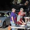 St. Vincent de Paul Men's Club members filling orders at the drive-thru section of their weekly Lenten fish fry on March 24th. (NTC photo/Donna Ryckaert)